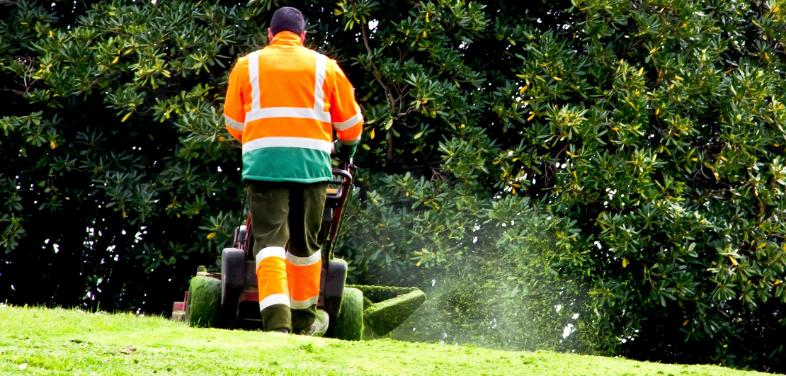 A man mowing a lawn.